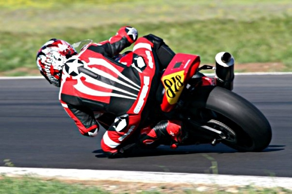 Motorcycle knee-dragging at track