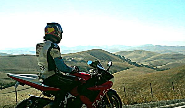 Motorcycle rider with scenic background