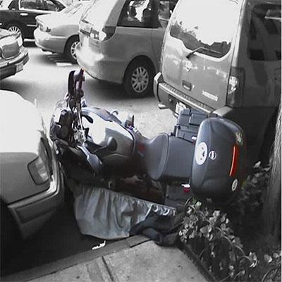 Motorcycle parking crash