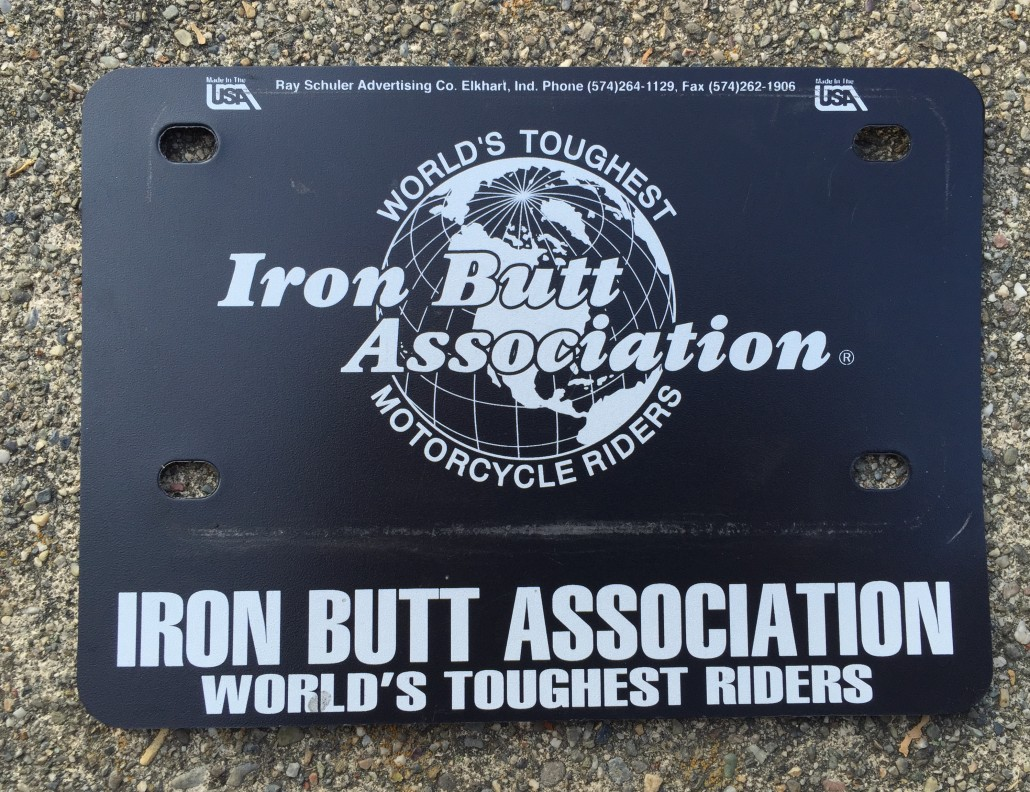 Iron Butt Association members get a pin and a license plate holder upon completion of a membership-qualifying ride. Photo credit: L. Kapitzky