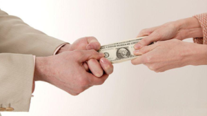 image of two people fighting over cash, emphasizing the confusion of Insurance subrogation for motorcycle accident claims