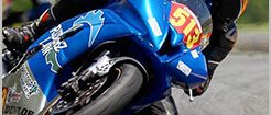 RiderzLaw motorcycle racer scraping knee