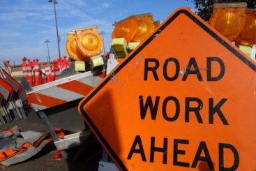 """""""Road Work Ahead"""" sign used to show that construction zones can cause motorcycle accidents"""