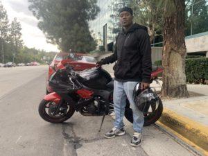 Michael Johnson standing next to his custom Yamaha R6