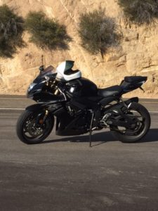 black sportbike parked in the canyons