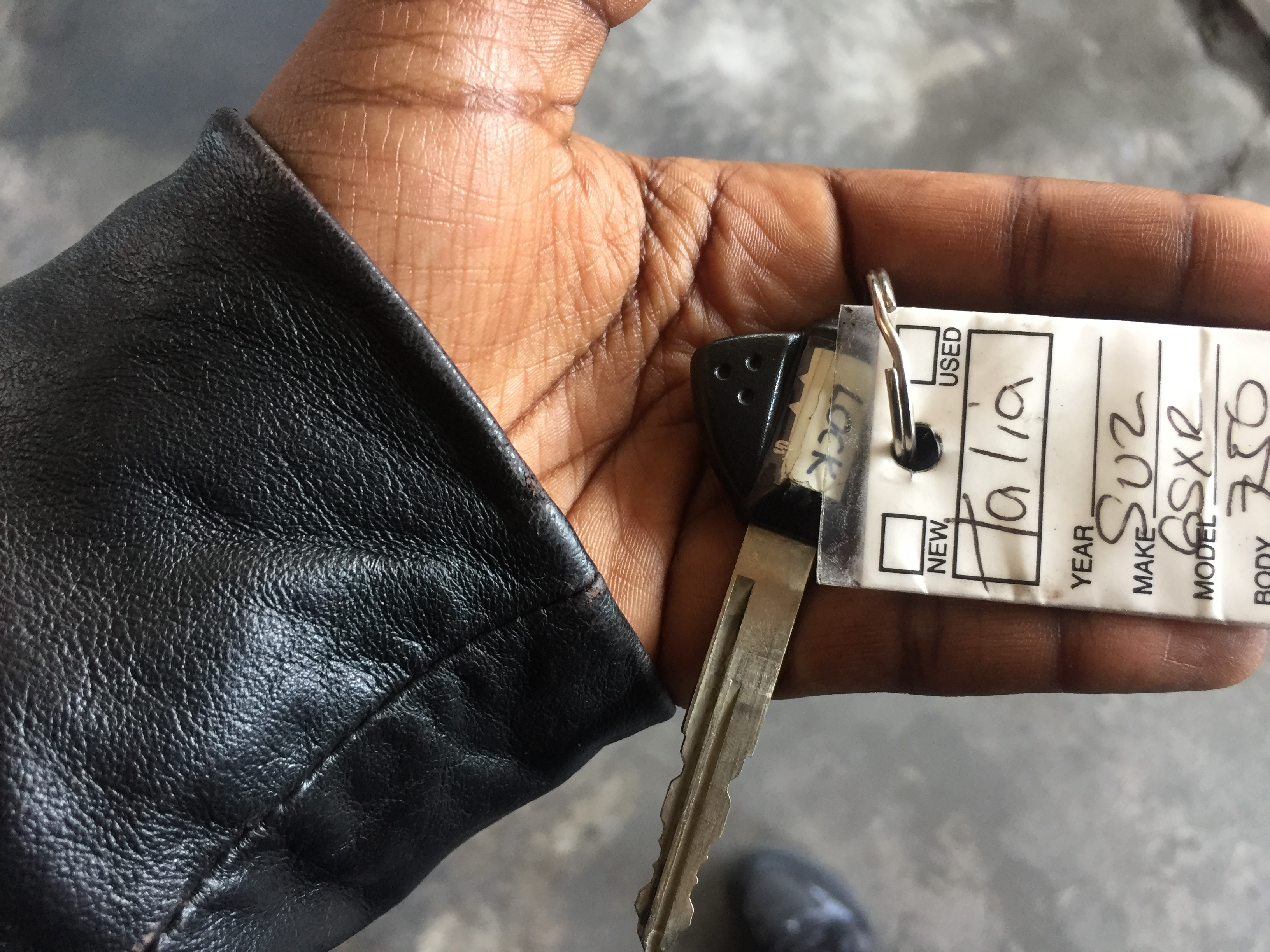 brand new motorcycle key in hand