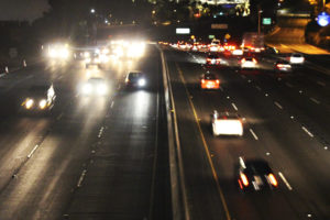 view of highway at night from overpass