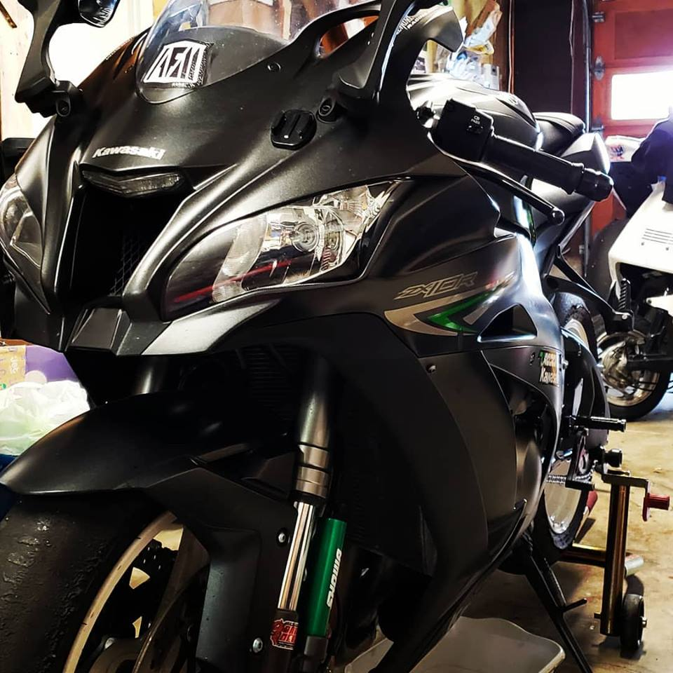 close up view of Kawasaki Ninja ZX10R with showa front suspension upgrades and AFM sticker