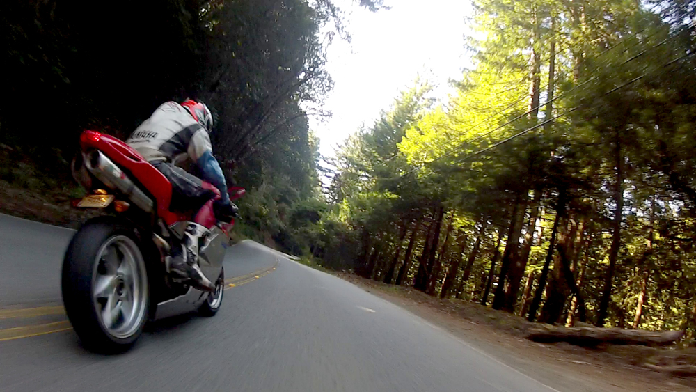 Windy 2 lane highway with sportbike zooming by