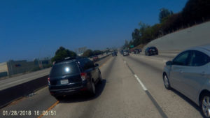 Motorcycle POV lane splitting on the 10 near Los Angeles