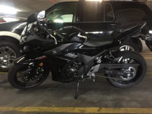 Black Suzuki GSXR250R parked in a parking space