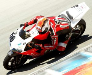 Motorcycle racer tight on the inside of a turn