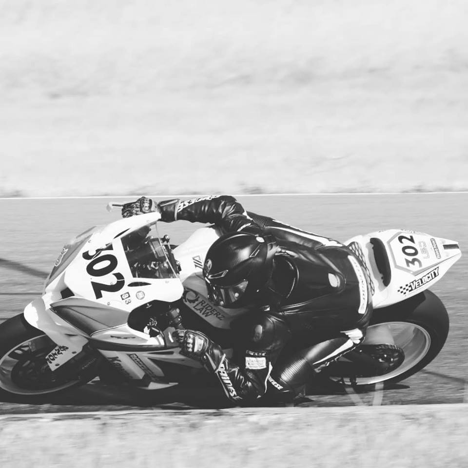 Female motorcycle racer AJ hitting the Apex on her Kawasaki ZX10