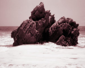 Jagged rocks jutting from the ocean