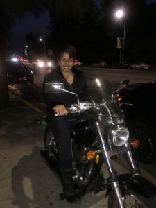 Rider on her cruiser at night