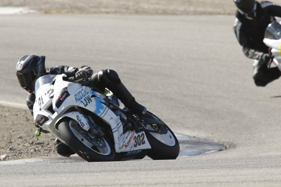 RiderzLaw Racer AJ Jacobsen riding her Kawasaki ZX10 motorcycle after a terrible accident