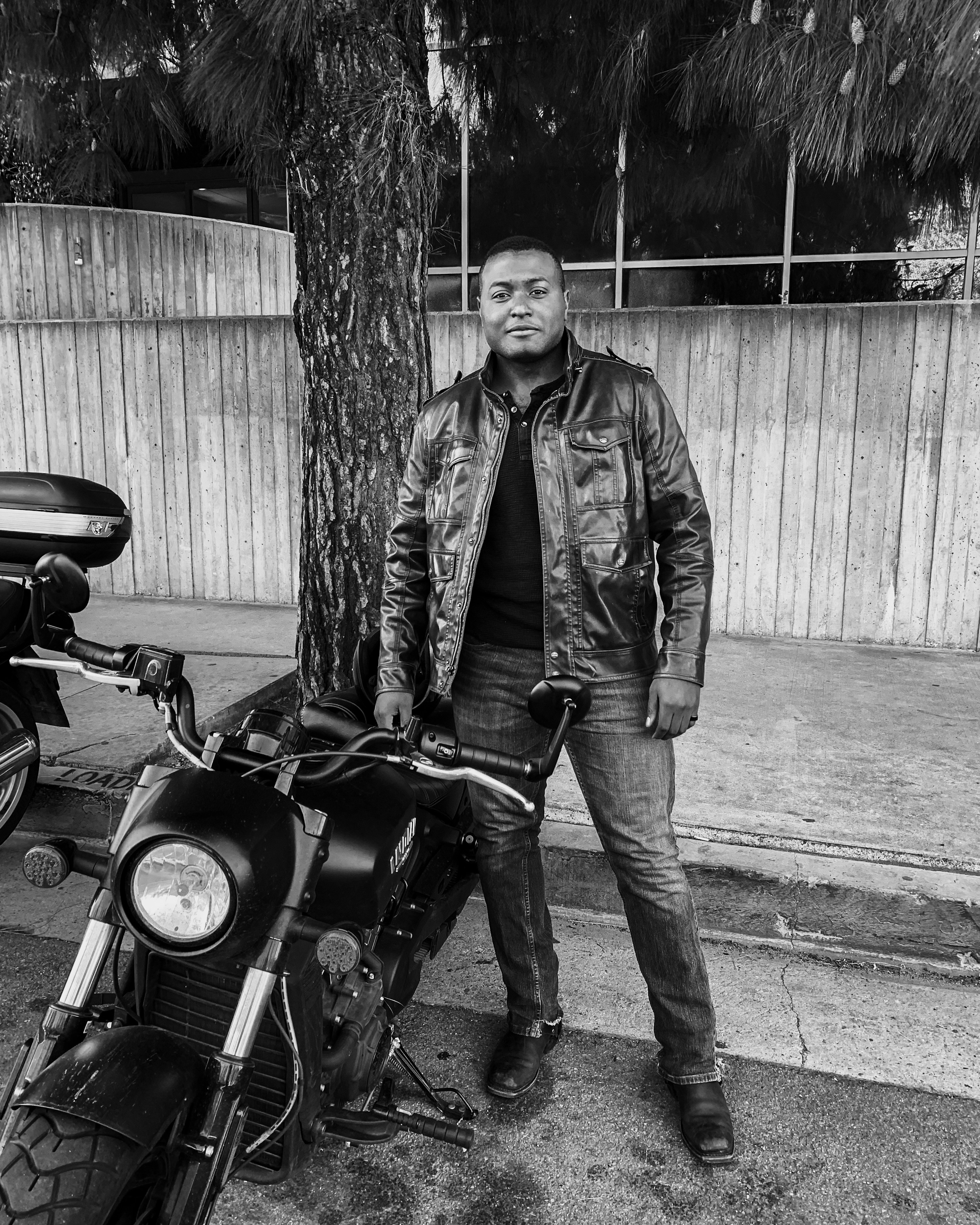 Vincent next to his Motorcycle