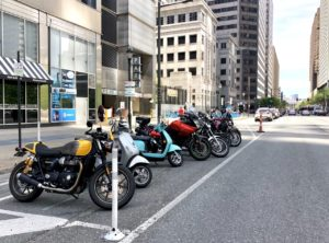 View of motorcycles and scooters in motorcycle parking typical of California Culture's favor toward efficient commuter vehicles
