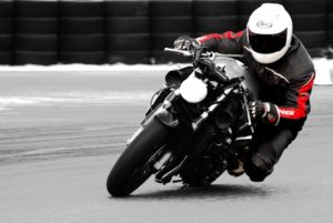 head on view of a Honda CBR600 f4i motorcycle with rider leaning into a left turn