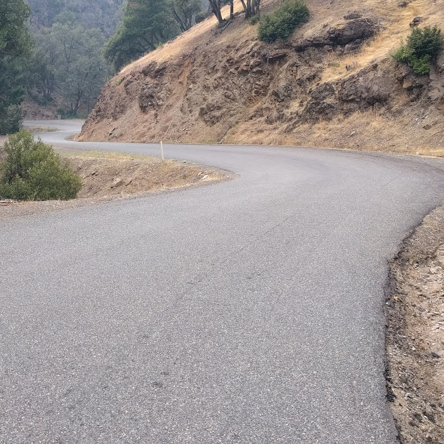"""A windy paved mountain road, perfect for motorcycle """"canyon carving"""""""