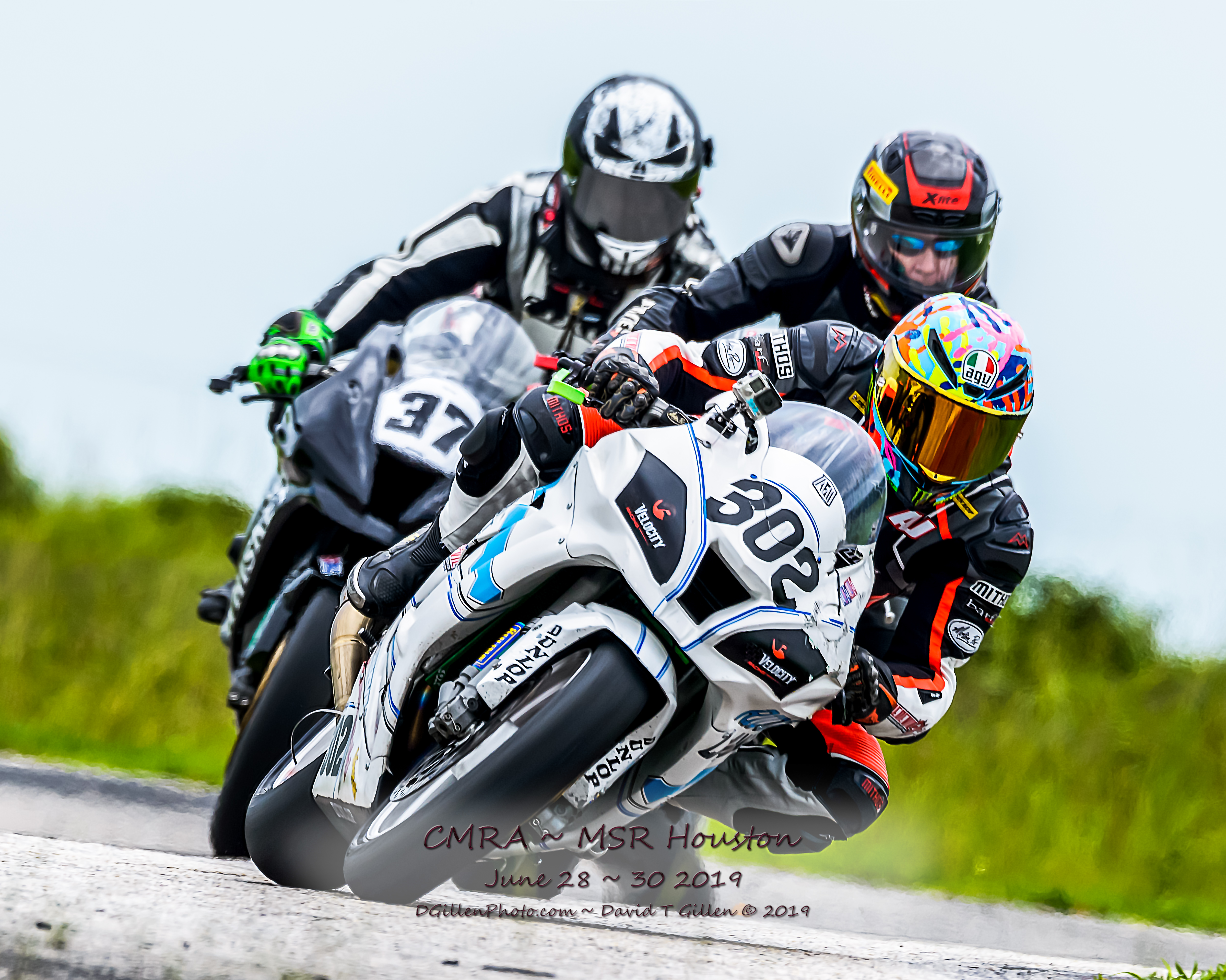 RiderzLaw Motorcycle Racing leads the pack during another CMRA race
