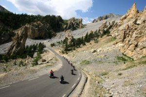 A group of motorcyclists carving their way through a scenic jagged canyon in California USA