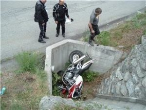 Motorcycle crash where the bike smashed into a deep drainage ditch