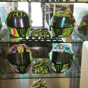 4 Monster Energy Motorcycle racing sponsored Rider helmets including Valentino Rossi's in display case