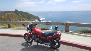 Classic 1983 Honda Nighthawk 750 parked next to the Pacific Ocean in the Bay Area in California