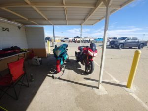 Two Sportbikes prepped for racing under a roof at Chuckwalla Raceway