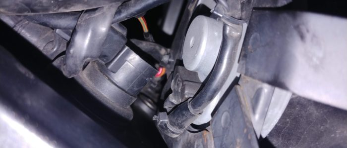 Yamaha FZ1 Motorcycle coil pack closeup with burnt insulation